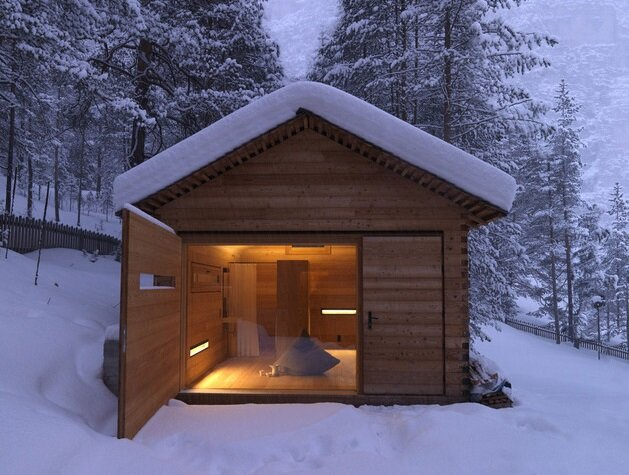 A small wood clad mountain cabin by em2 architekten for Wood cabin homes