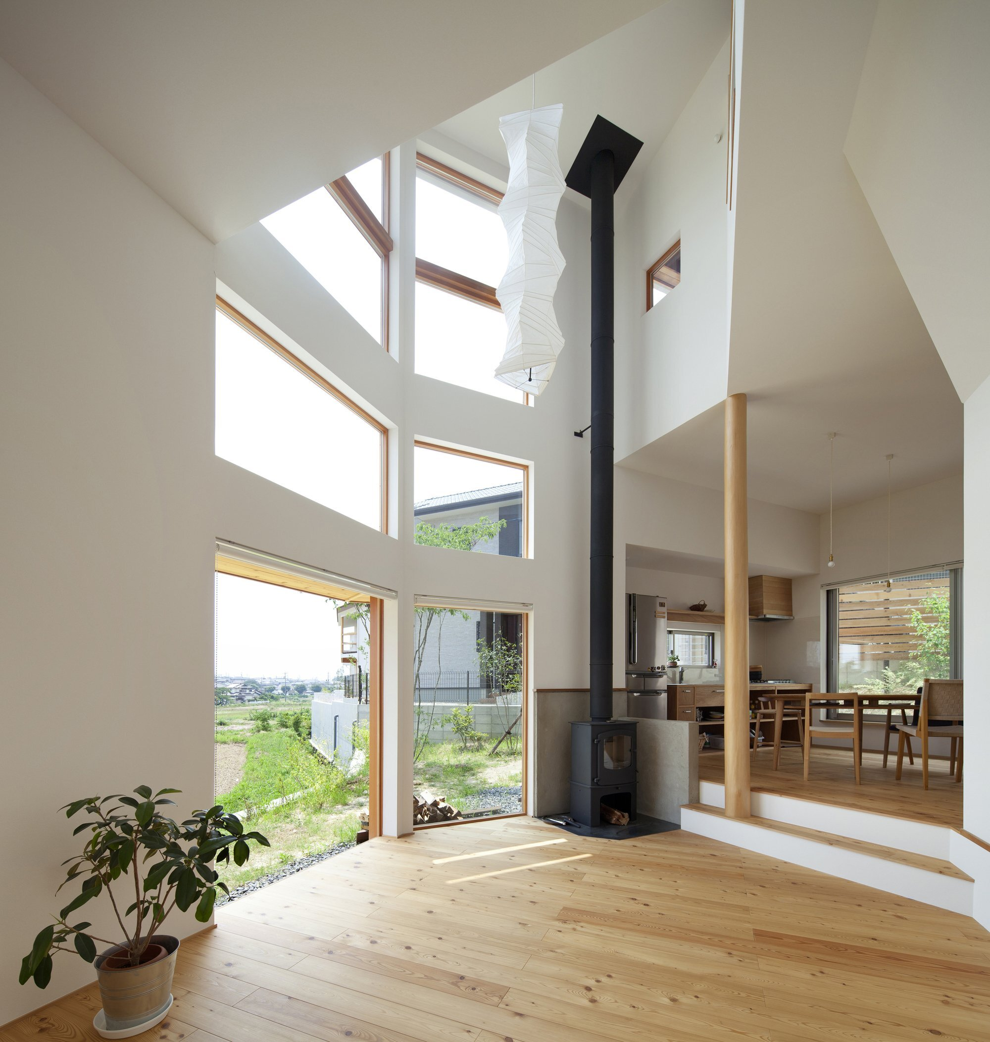 Gandare house a narrow japanese home by ninkipen for Modern japanese house interior design