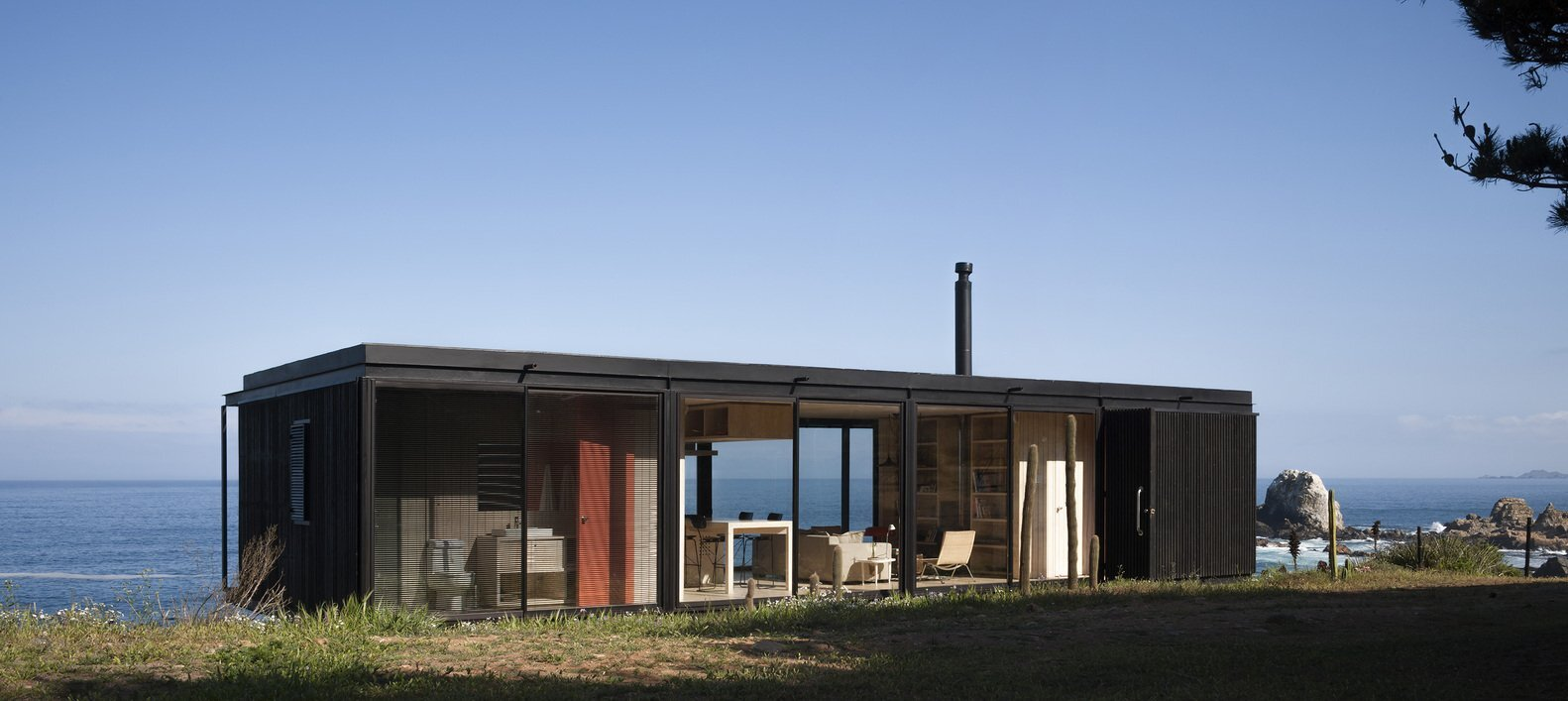 remote house a small prefab home set on the coast of chile - Modular House