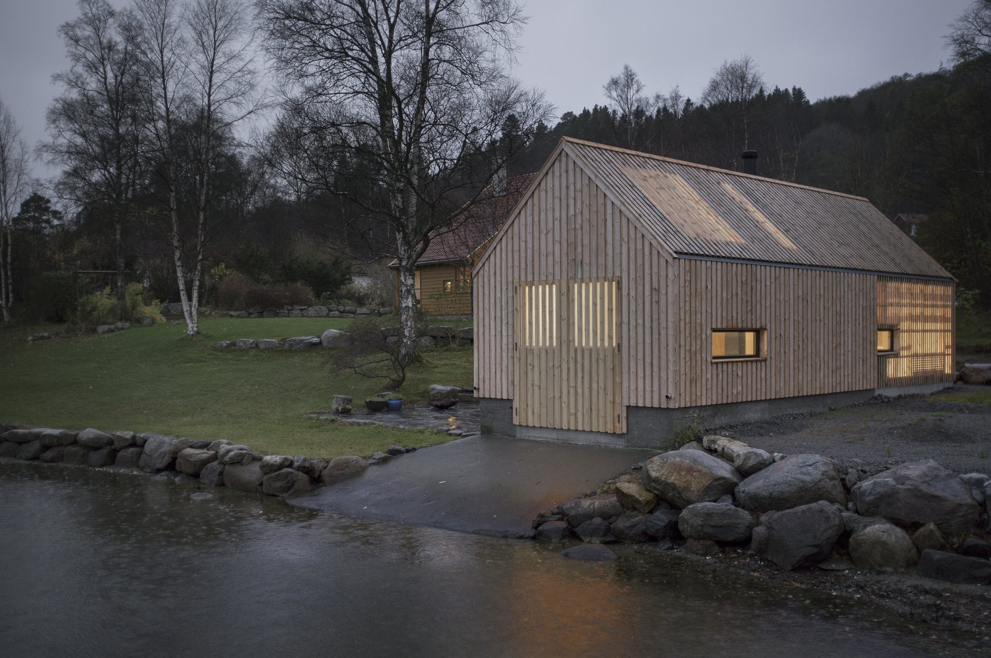 Naust v a cozy boathouse with transparent walls for Modern house design norway