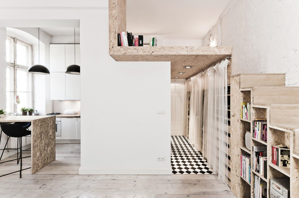 Small Apartment Incorporates Mezzanine Bedroom To Maximize On Space