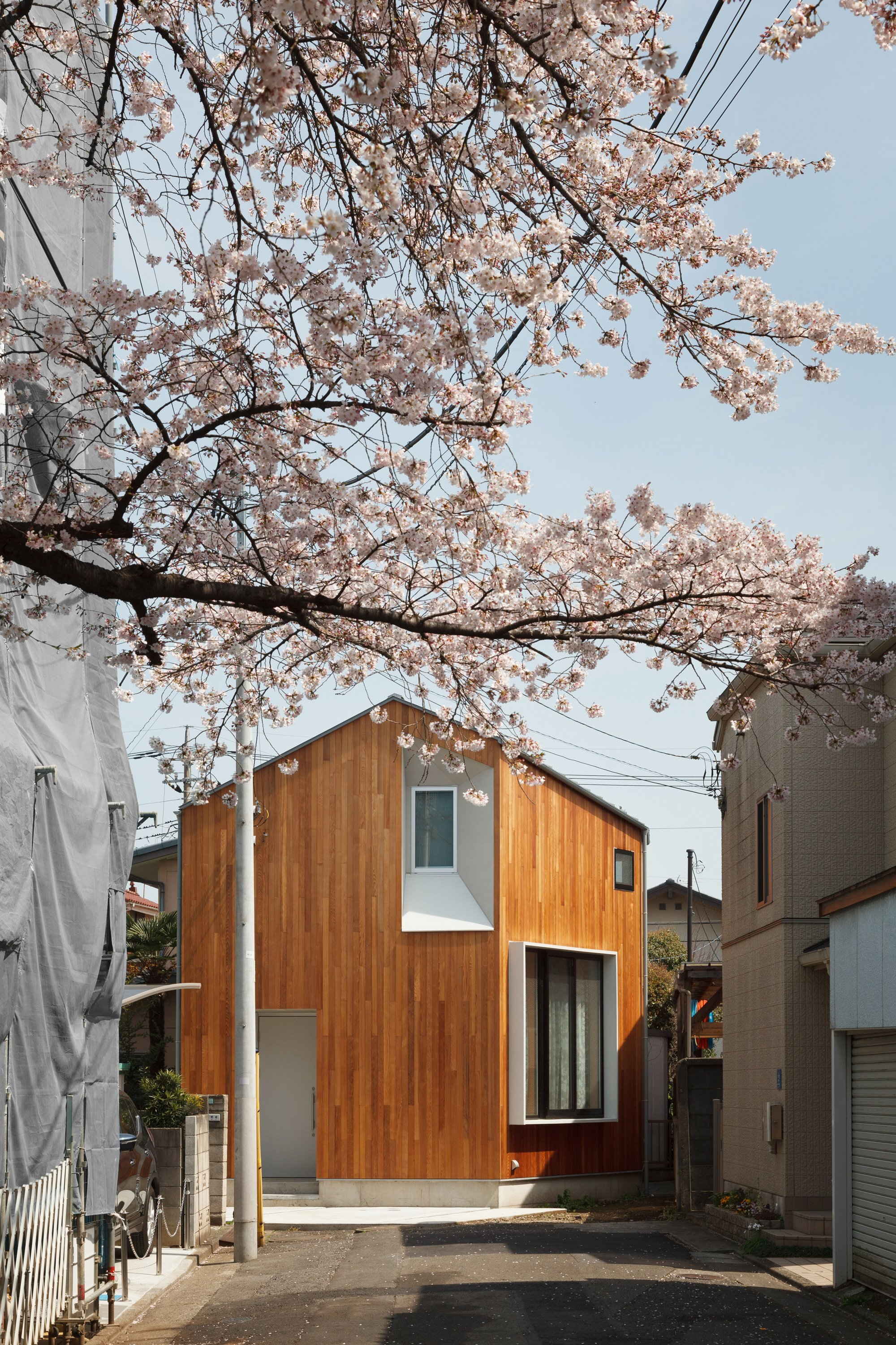 House u a small house on a corner lot in tokyo for Local residential architects near me