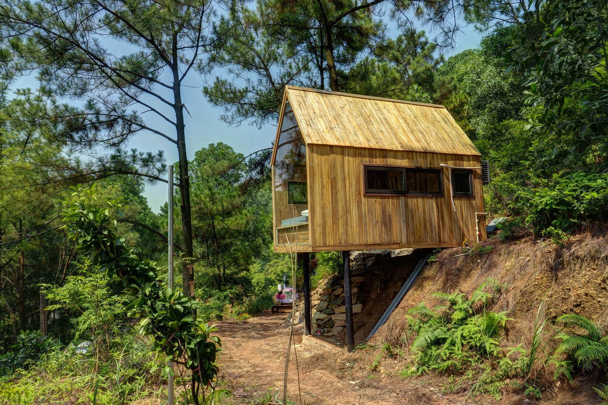 Forest house is a tiny work sleep retreat from vietnam for Small house design vietnam